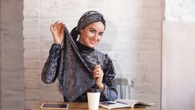 Young muslim woman in head scarf smile. Young muslim woman in head scarf smile stock footage