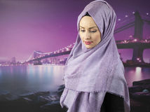 Young muslim woman in office. Young muslim woman portrait with islamic dress and scarf Royalty Free Stock Photography