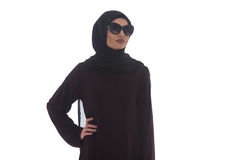 Young Muslim Woman Portrait. Fashion Portrait Of Young Beautiful Muslim Woman With Black Scarf And Sunglasses Isolated On White Background Royalty Free Stock Photography