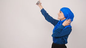 Young muslim woman posing taking selfie photo with mobilephone. Indoor stock video