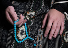 Young muslim woman pray in mosque Stock Image