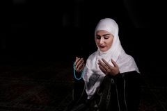 Young muslim woman pray in mosque Stock Photos