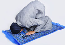 Young muslim woman praying. On traditional way Royalty Free Stock Image
