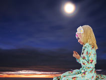 Young muslim woman praying for Allah Royalty Free Stock Image