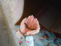 Young muslim woman praying for Allah Royalty Free Stock Photos