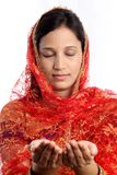 Young muslim woman with praying hands Stock Photo