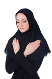 Young muslim woman praying. Isolated on white Stock Image