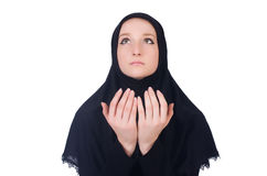 Young muslim woman praying. Isolated on white Royalty Free Stock Photos