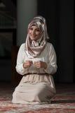 Young Muslim Woman Praying Stock Image