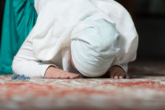 Young Muslim Woman Praying. In Mosque Royalty Free Stock Photos
