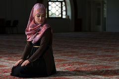 Young Muslim Woman Praying In Mosque Stock Photos