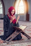 Young muslim woman praying with rosary in mosque.  Stock Images