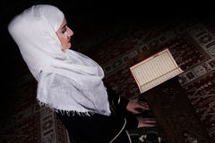 Young muslim woman reading Koran Royalty Free Stock Photo