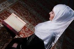 Young muslim woman reading Koran Royalty Free Stock Photos