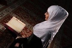 Young muslim woman reading Koran Royalty Free Stock Images