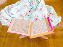 Young muslim woman reading Quran Royalty Free Stock Photo