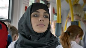 Young muslim woman in sitting in bus, transport concept, urban concept, thinking concept.  stock footage
