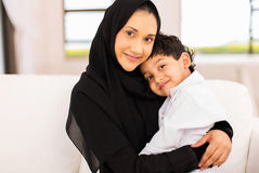 Young muslim woman son Stock Images