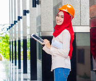 Young Muslim woman standing on column background Stock Photography