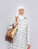 A young muslim woman in traditional clothes caring Royalty Free Stock Images