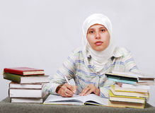 A young muslim woman in traditional clothes in edu Royalty Free Stock Photo