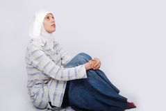 A young muslim woman in traditional clothes siting Royalty Free Stock Photos
