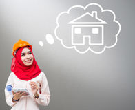 Young Muslim woman wearing a protective helmet Stock Photography