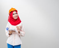 Young Muslim woman wearing a protective helmet Stock Photo