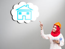 Young Muslim woman wearing a protective helmet Stock Photos