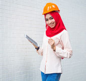 Young Muslim woman wearing a protective helmet Royalty Free Stock Images