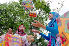 Young Muslim women. With presents in the air Royalty Free Stock Images