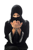 Young muslim women pray looking down royalty free stock photos