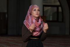 Young Muslim Women Praying In Mosque Stock Image