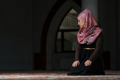 Young Muslim Women Praying In Mosque Stock Photography