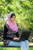A Young Muslim Women using a laptop. A Young Muslim Woman with a laptop Royalty Free Stock Photography