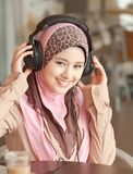 Young muslim women wearing head phone Stock Photo