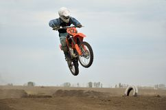 Young MX racer on a jumping from a hill Royalty Free Stock Photography