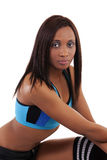 Young mxed woman in exercise attire 1/2 length Stock Image