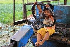 Young Myanmar child play to drive Royalty Free Stock Photography