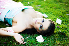 Young mysterious woman with cards in the grass Royalty Free Stock Images
