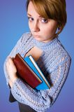 Young naive girl holding a books Royalty Free Stock Photography
