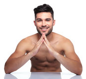 Young naked beauty man making a house with his hands Stock Photos
