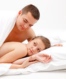 Young, naked couple in bed Stock Images