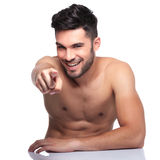 Young naked man pointing finger to camera Stock Photos