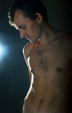 Young naked men on dark Royalty Free Stock Images