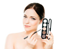 Young naked woman with a makeup pallet Royalty Free Stock Image