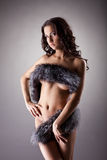 Young naked woman stand relaxed in fur Stock Images