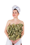 Young naked woman in towel with oak broom. On isolated white background Stock Photography