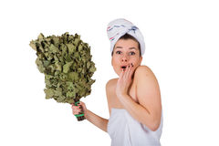 Young naked woman in towel with oak broom. On isolated white background, surprised face Stock Photos