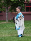 Young Native Dancer. A young dancer in full regalia participates in a powwow. National Aboriginal Day Powwow June 17, 2008 in Abbotsford, British Columbia royalty free stock photography